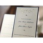 Modern chandelier designed wedding invitation featuring silver foil stamp, raised lettering and black backing card