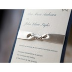 Satin silk ribbon up close, with Italic raised letting, white flat card