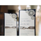 Long and slim dark blue invitation with personalised raised ink printing