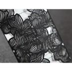 Black floral laser cut detail closeup
