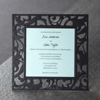 Black laser cut invitation with swirls, blue inner paper