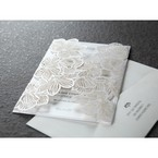 White gatefold invite, intricate laser cut sleeve, pearlised insert card