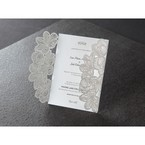White card printed in black raised ink, set in a pocket invite with laser cut sleeves