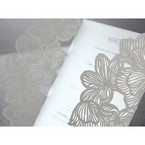 Intricate white matte laser cut sleeve with a wild lotus flower pattern, and light grey inner card