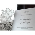 Gatefold invite with laser cut details and light grey inner card with black ink print
