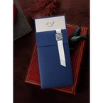 Navy blue pocket wedding invitation with white satin ribbon and crystal accent, pearl paper insert