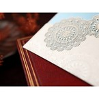 White matte lasercut pocket with floral design details