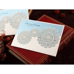 White half pocket wedding invitation with Victorian doily patterns and lace trim, blue inner paper