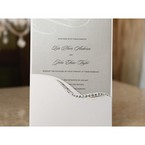 Cropped image of the white invitation embellished with swarovski gems and swirl patterns in gray, black and white