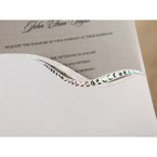 Zoomed in jewel liner of white pocket invitation