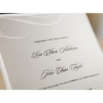 Personalised black text, raised ink against gray insert featuring swirl pattern
