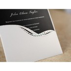 White pocket style invite with jewel embellishment and swirl design
