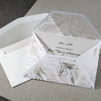 White lasercut peacock wrap, unfolded, white inner card, thermography