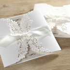 Ivory coloured insert card inside a matte white gatefold invite, secured by a knotted silky smooth lace