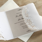 Floral lasercut sleeve on a white gatefold invite with pearlised insert card printed in black high rise fonts