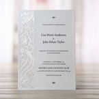Raised ink lettering, embossed white pearlized paper, border accent, laser cut invitation