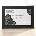 Pocket style floral invitation featuring wild flower patterned laser cut design, raised ink lettering and ivory insert