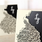 Zoomed in white matte card pocket invitation, peacock laser die cut detail