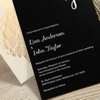 Black and white invitation featuring a digital print with custom monogram and white font