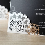 Zoomed in view of the floral laser cut design, golden brown and white