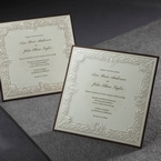 Square wedding invitation featuring embossed Victorian patterns in the frame