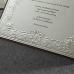 Raised bottom part of the layered vintage invite with embossing and pearl finish