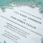 White inner paper featuring black raised lettering in tiffany blue laser cut sleeve