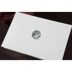 White fold type invitation accented with a laser cut monogram design and foil stamping