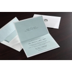 Wide open folded type invitation with raised blank ink and matching envelope with blue liner