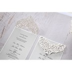 Shimmering silver coloured insert card set on a matte white backing layer with lasercut details and jewel drop