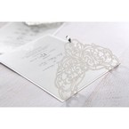 Pearlised light grey card set on a white backing layer with an intricate Victorian themed lasercut pattern