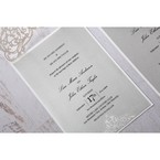 Matte white backing card with lasercut flap adorned with crystal stud, printed in raised ink calligraphic writing