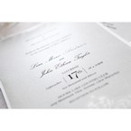 Shimmering light grey insert paper with black high rise calligraphic fonts, set on a white backing card