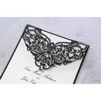 Black intricate laser cut designed flap cover adorned with jewel, set on a black backing layer