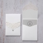 Classic white pocket invite with intricate lasercut pattern on flap, adorned with a crystal gem