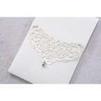 Lightly textured pocket invite card stock, with an elegant lasercut detail, and crystal stud