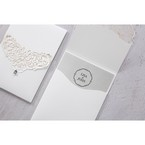 Light grey insert card enclosed in a lightly textured pocket with vintage lasercut pattern and jewel detail