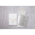 Shimmering silver insert card printed in black calligraphic letters, white pocket invite, intricate lasercut details