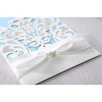 Classic white pocket invite with intricate vintage theme lasercut design wrapped with a white lace knotted ribbon
