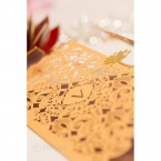 Vintage themed laser cut sleeve with lotus flower seal, marsala inner card