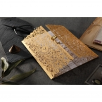 Matte white pearl inner card enclosed by a golden laser cut gatefold invite with wild lotus center seal