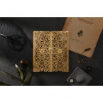 Gatefold invite with golden intricate laser cut pattern sleeves and matte navy blue card