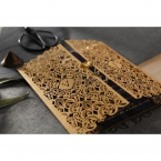 Matte golden laser cut sleeve with a shimmering dainty flower seal