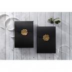 Shimmering black charcoal coloured pocket invite sealed with an elegant golden wax stamp