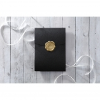 Shimmering black coloured pocket invite with a wax seal stamp in stunning golden colour