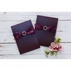 Charming marsala coloured ribbon adorned with a crystal embellishment wrapped around a shiny deep marsala pocket invite