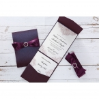 Regal themed border draped over the white insert card and stationeries, enclosed in a deep marsala pocket with satin ribbon