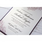 Shimmering pearl insert card printed in black raised ink calligraphic fonts with regal themed border design on a purple backing