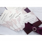 Matching stationeries of different sizes on a pearlised paper with light purple vintage themed border, purple satin ribbon with gem