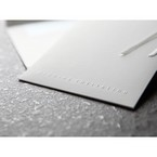 Zoomed in view of the embossed text, invitation pocket in white